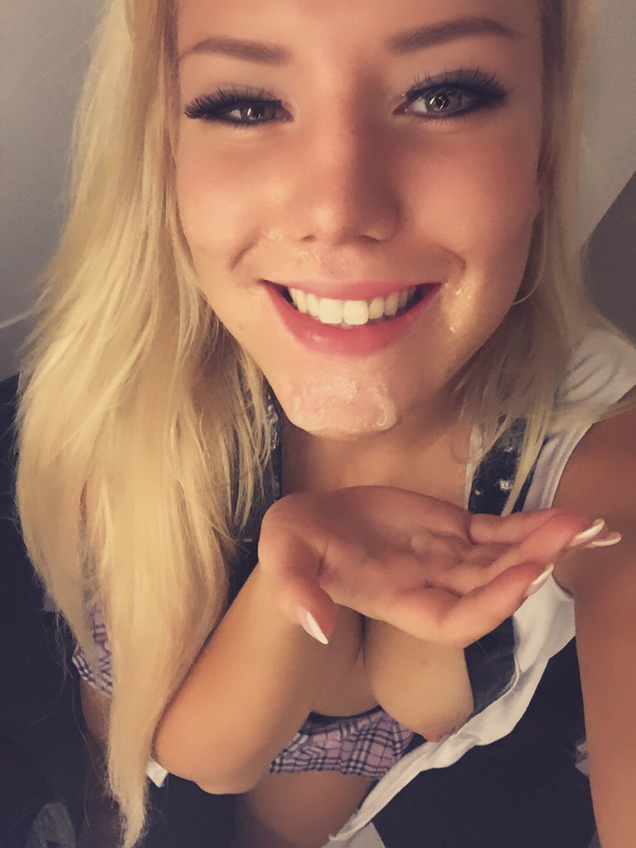 Beautiful blonde taking a selfie after a facial