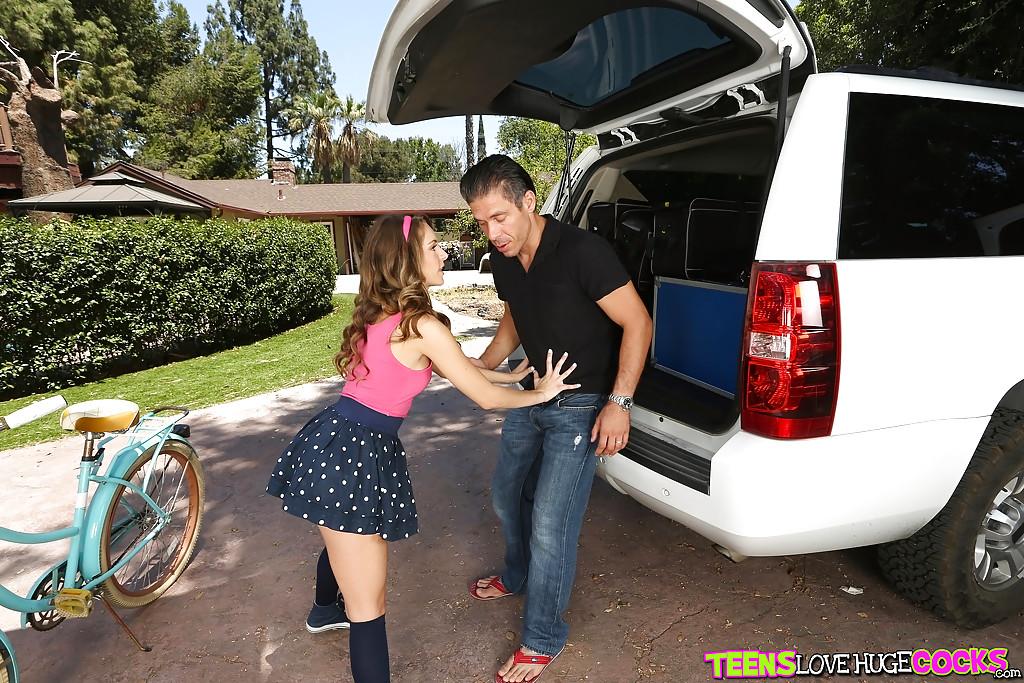 Teen girl Kimmy Granger giving blowjob in driveway in skirt and knee socks
