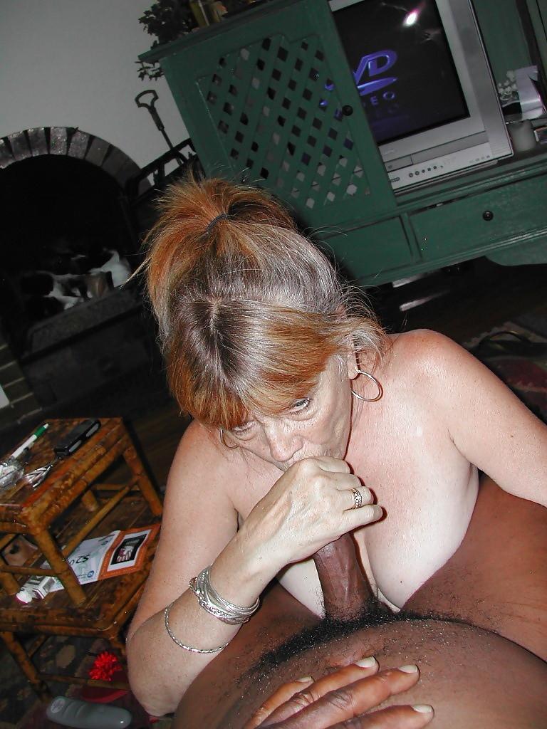 Redhead wife sucks two black cocks before penetration