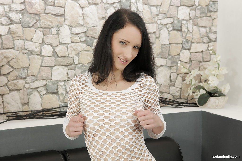 Sweet and sexy brunette in fishnet dress self fisting shaved cunt
