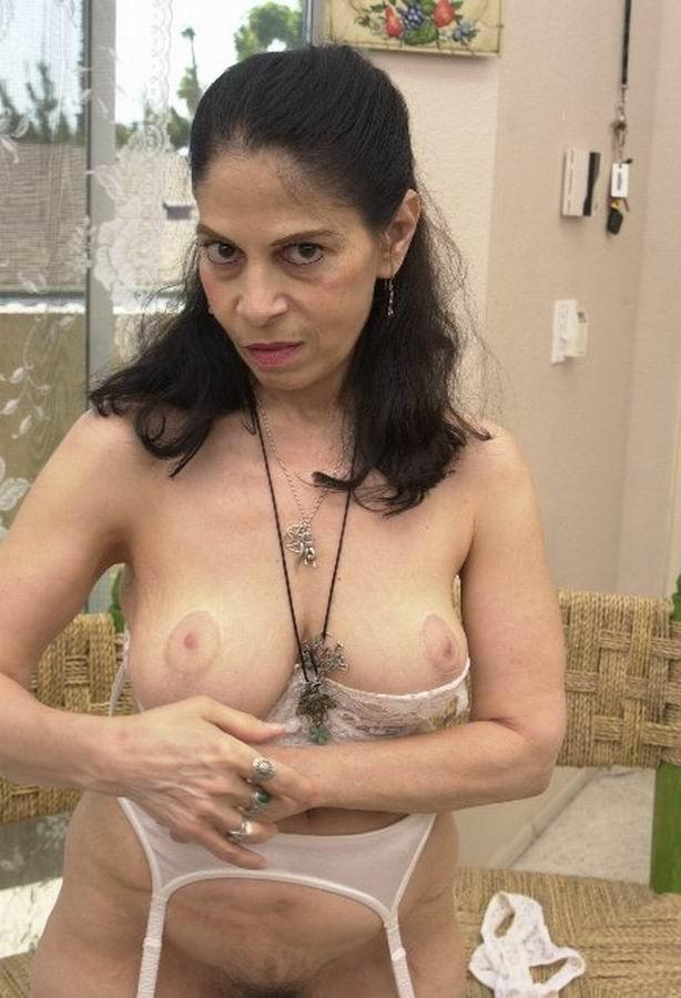 hot amateur granny posing naked on balcony