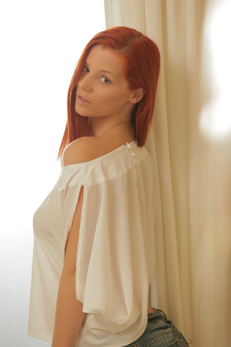 Sexy erotic redhead babe Ariel strip teasing