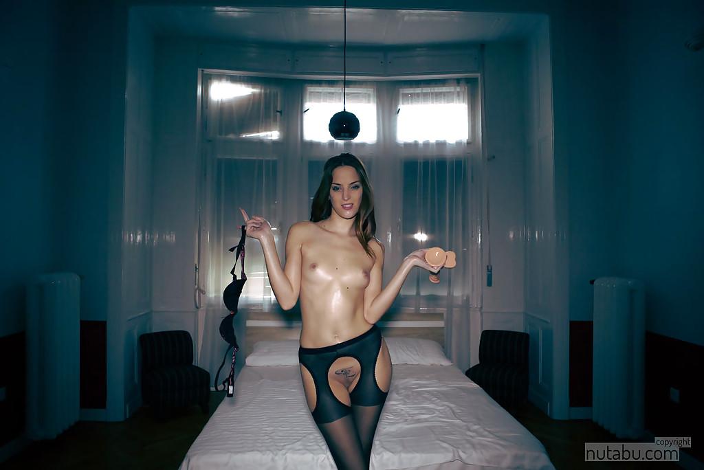 Sexy amateur chick in black stockings masturbating horny vagina with dildo