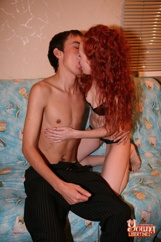 Young redhead gives a nice blowjob and rides cock on the couch