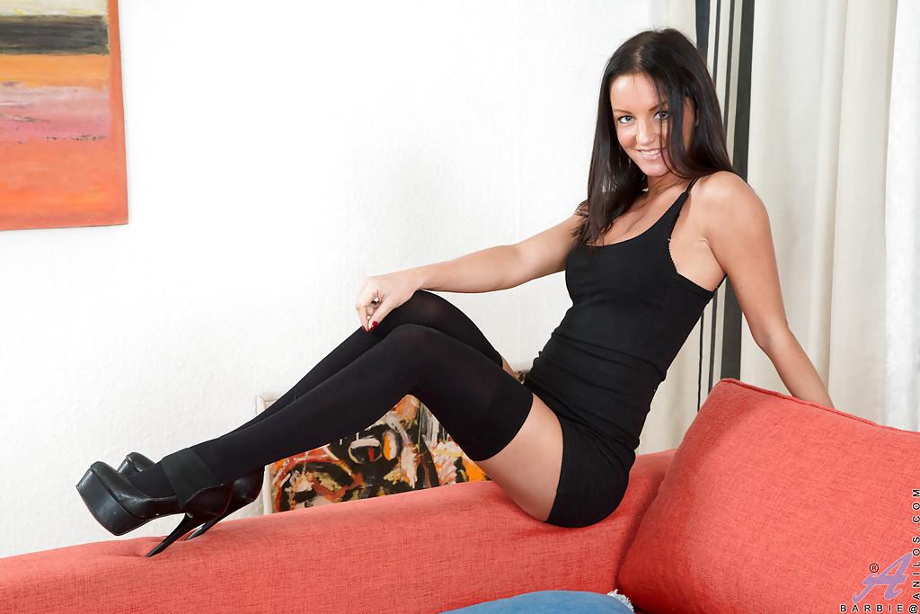 Nylon and high heel adorned brunette babe masturbating MILF pussy