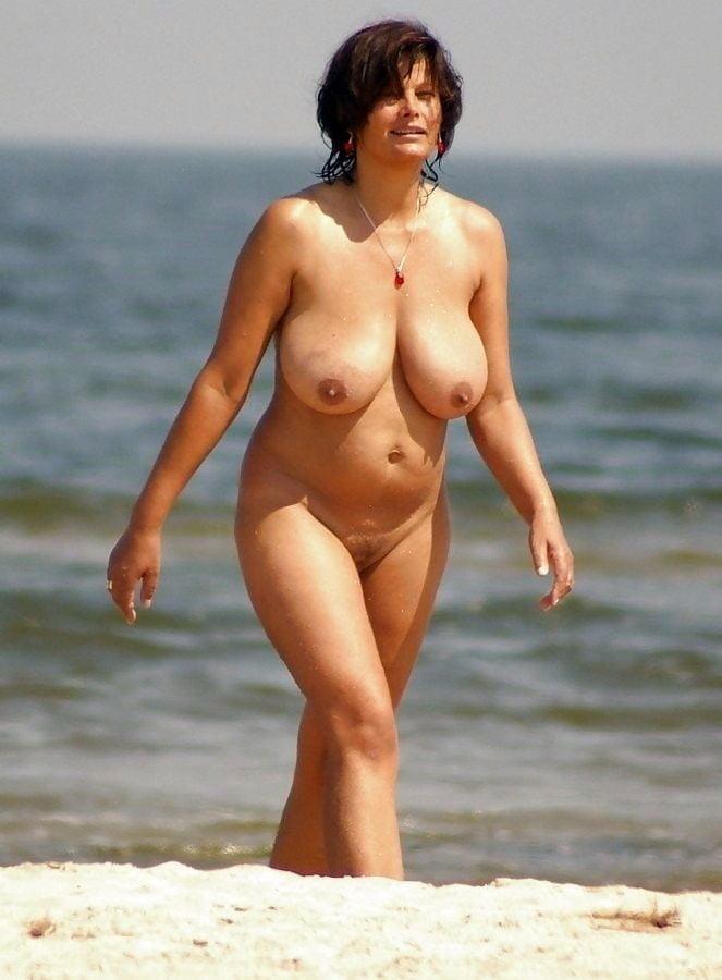 Sexy mom on the nudist' beach
