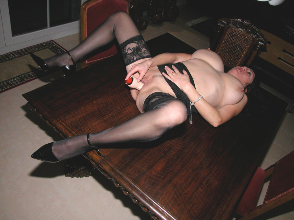 Mature with big tits spreads legs to use dildo